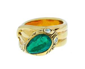 Yellow gold snake ring with diamond eyes and emerald