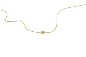 Yellow gold bracelet with a diamond heart