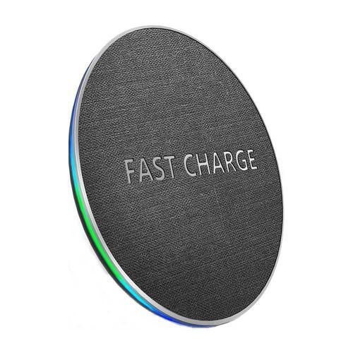 Fast Wireless Charging Pad on top of plain white background