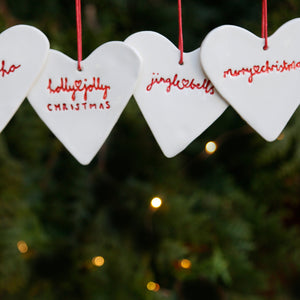 Set of 4 Heart Hanging Ornaments with Hand Lettering Style Christmas Lyrics