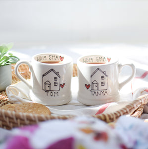 A set of Personalised New Home Mugs
