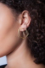 "18k yellow gold pentagon cage earrings are the perfect accessory to make a modern, elegant statement. Pairs well with Meg C's Pentagon Bracelet!   Size: 1.5"" h x 1.5"" w Style: Button Metal: 18k Yellow Gold Handmade by Meg C"