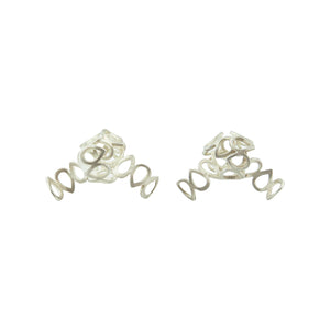 One-of-a-kind knotted lace earrings, cut out and formed by hand, in sterling silver.   Size: 30mm wide Style: Button Metal: Sterling Silver Handmade by Meg C