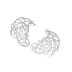 Intricate, hand-cut lace earrings in sterling silver, with 14k white gold posts.   Size: 45mm long Style: Drop Metal: 14k White Gold Post; Sterling Silver Handmade by Meg C
