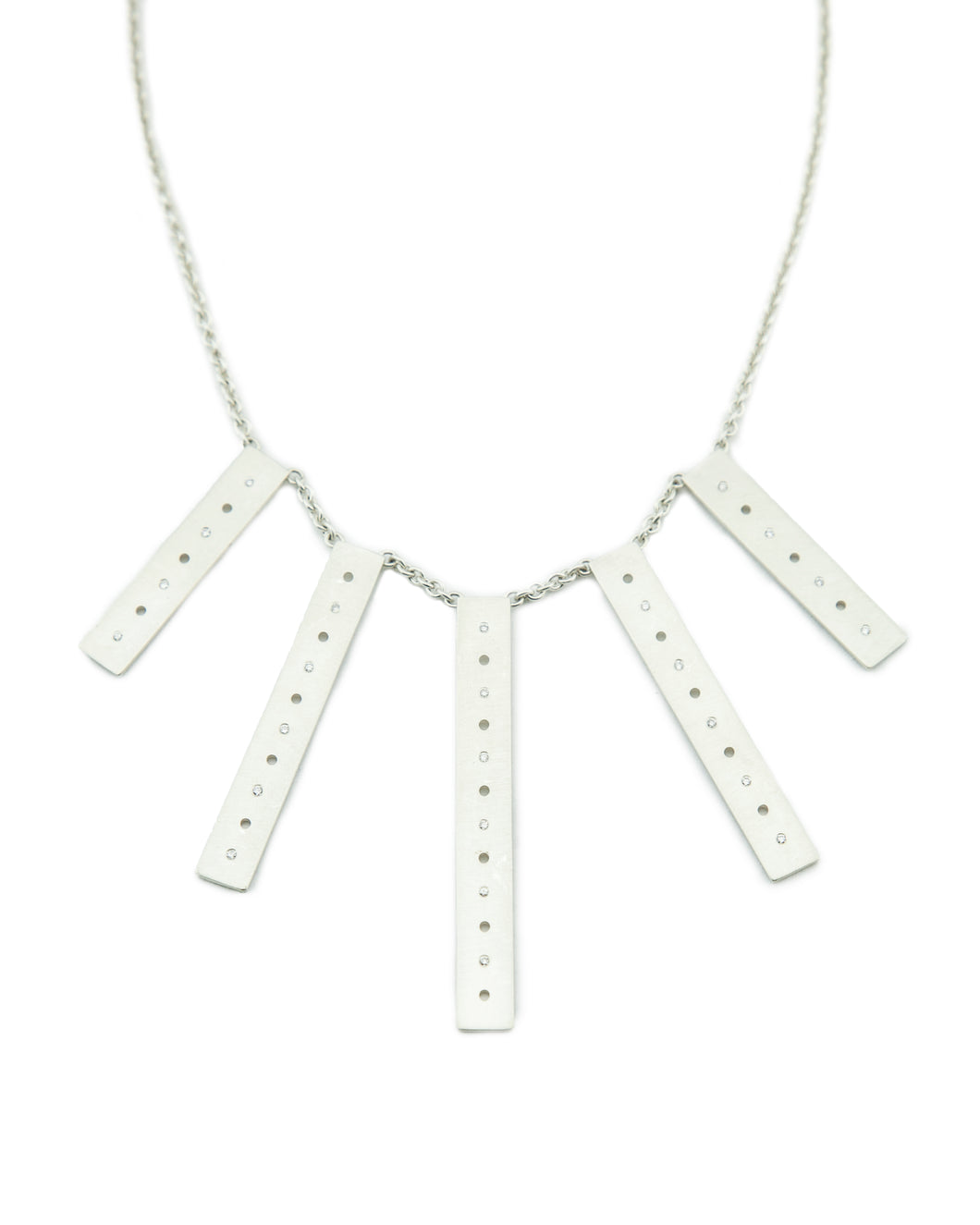 Clean and sleek, sterling silver and diamond bar statement necklace.   Size: Bars vary from 40mm-60mm long; 8mm width; 18