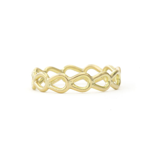 An open eternity band, reminiscent of lace in a pear shape.   Metal: 18k Yellow Gold Handmade by Tura Sugden