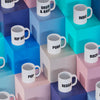 Birds eye view of Limited Edition Music Mugs arranged on colourful boxes