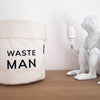 Pikkii Waste Man Bin next to a Saletti Monkey Lamp