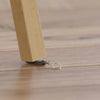 WonKey Keyring - Fixes Wobbly Tables - under table leg on wooden flooring background