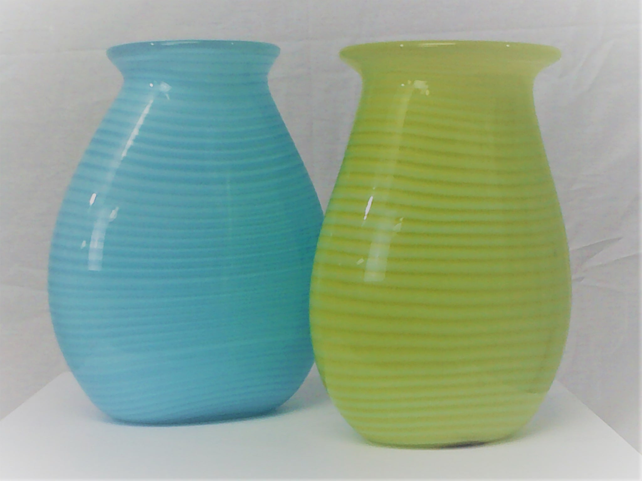 "A Rare Pair  Tiffany Art Glass Vases  7 ½"" h x 6"" w  $750  Both vases are signed by the artist Jamie Harris for Tiffany and Co.  One is dated 2002 and the other 2003.  It's rare to find a pair of these stylish vessels, perfect for a bouquet of tulips of just for display.  Harris is a 43-year old glass artist working and living in NYC.  We understand his stint with Tiffany was only for about a year, which makes theses vases even more precious and likely to appreciate in value."