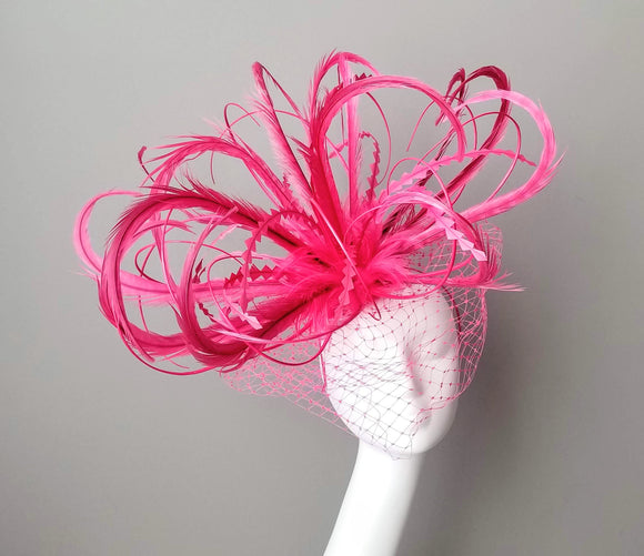 Pink fascinator with feathers for Kentucky Derby. Louisville Hat maker Hat Haven. Bespoke hats Louisville. Custom hat shop in Louisville Kentucky.