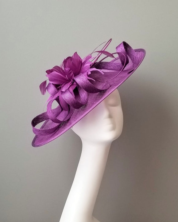 Purple fascinator for Kentucky derby. Custom hat maker Hat Haven in Louisville Kentucky. Hat shop Louisville.