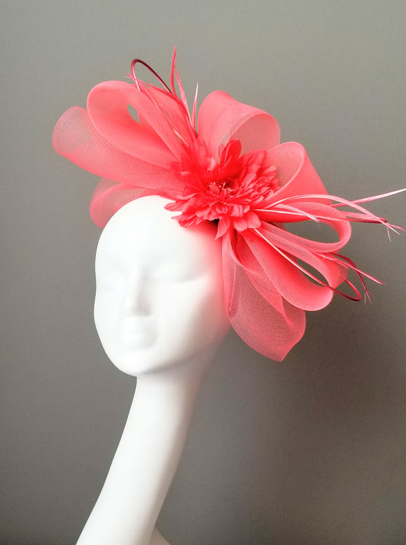Coral pink fascinator Kentucky derby hat shop Louisville Hat Haven bespoke hat maker