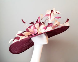 Burgundy Kentucky derby hat. Sinamay with feathers. Millinery hat shop Louisville. Custom hat maker Hat Haven.