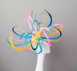 Multi colored fascinator for Kentucky derby. Millinery hat maker Louisville. Custom hat shop Louisville. Hat Haven hat shop.