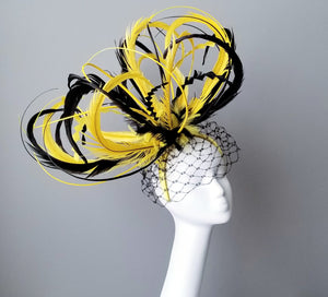 Yellow and black fascinator for Kentucky derby. Millinery hat shop Louisville. Custom hat maker Hat Haven.