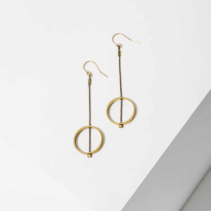 Larissa Loden Jewelry, handcrafted in MN. Horizon Earrings, Brass shape threaded with delicate antiqued chain. Earrings are approx. 2 inches long. Gold filled ear wires.