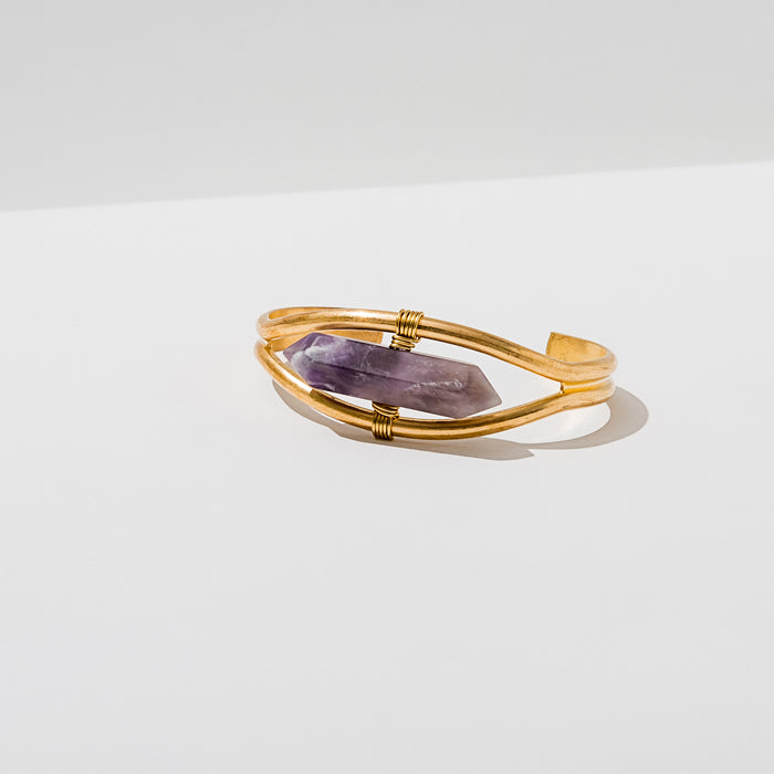 Larissa Loden Jewelry, Handmade in MN. Crystal Cuff Bracelet Gemstone pendulum wrapped into an adjustable brass cuff. Available in Amethyst, Quartz, Grey Quarts, Heihua Agate, Labradorite, Rose Quartz, Blue Lace Agate