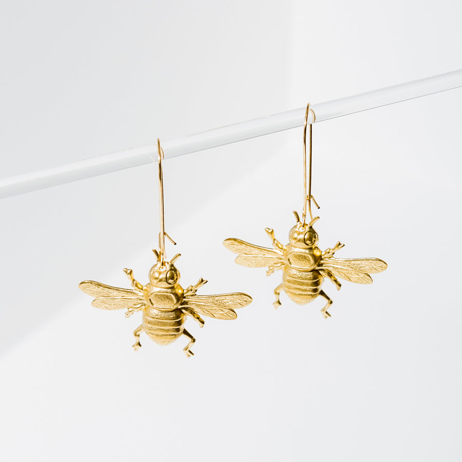 Larissa Loden Jewelry, Handmade in MN. Bee Earrings, Lightweight, brass or silver plated bees. Earrings are approx. 2 1/4 inches long. Gold filled and nickel free ear wires.