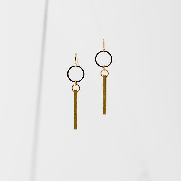 Larissa Loden Jewelry, Handmade in MN. Azibo Earrings, Black powder coated ring in contrast to the brass bar. Earrings are approx. 2 inches long. Gold filled ear wires.