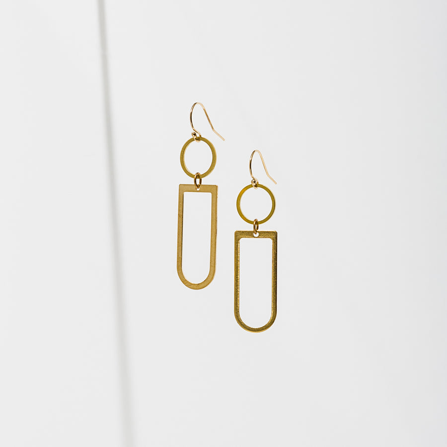 Simple hoop with a brass open shape below. Earrings are approx. 1 3/4 inches long. Gold filled and nickel free ear wires.