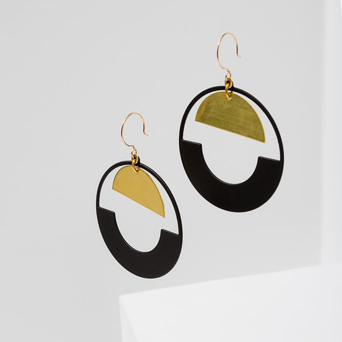 Larissa Loden Jewelry, Handmade in MN. Baltic Earrings, Large rubberized brass circle with brass half-moon component. Earrings are approx. 3 inches long. Gold filled ear wires.