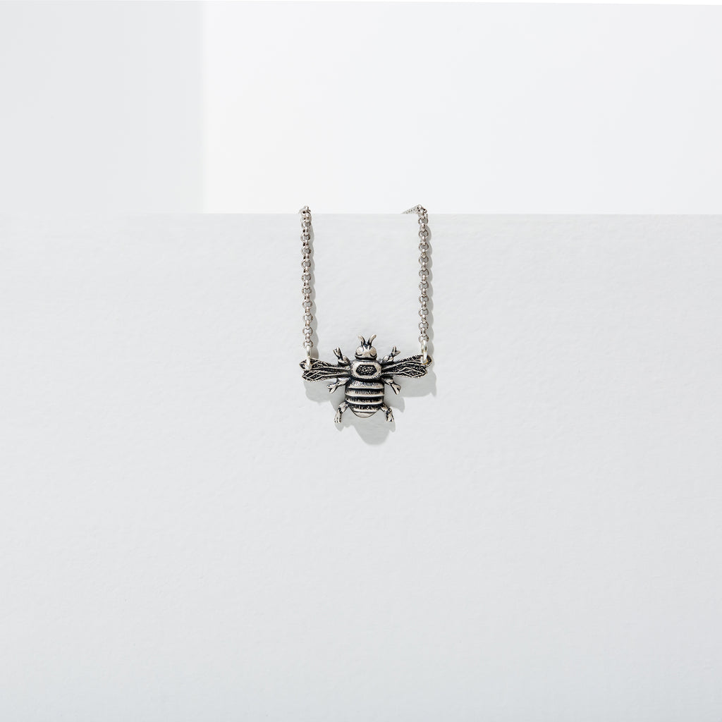 Larissa Loden Mini Bee Necklace https://larissa-loden.myshopify.com/products/mini-bee-necklace Brass or silver plated mini bee hangs from antiqued gold or silver chain. Necklace 18 inches long with clasp.