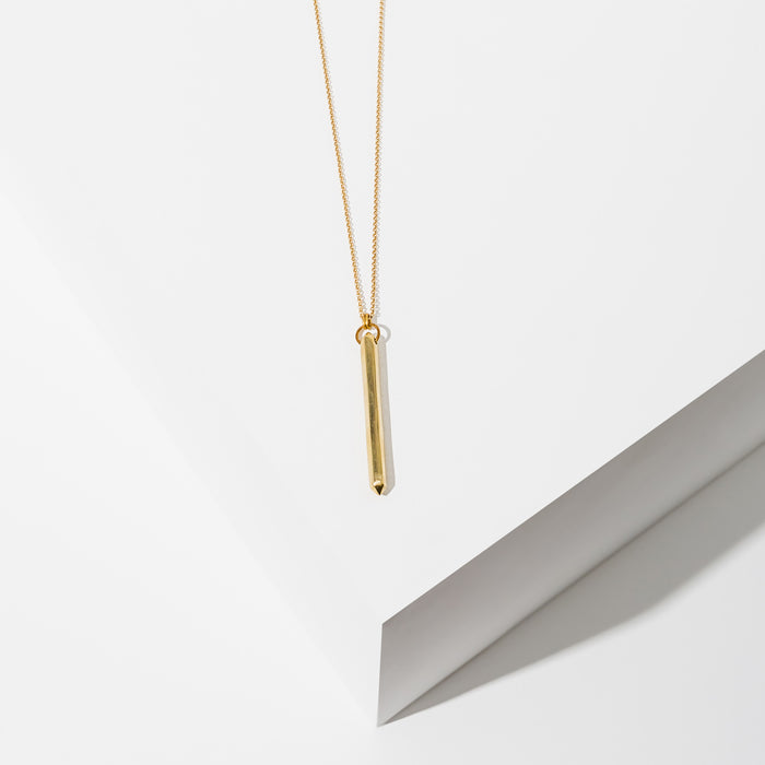 Larissa Loden Jewelry, Handmade in MN. Ebo Necklace, A simple, double-pointed pendulum hangs from matte gold or silver chain. Necklace is 30 inches long with clasp.