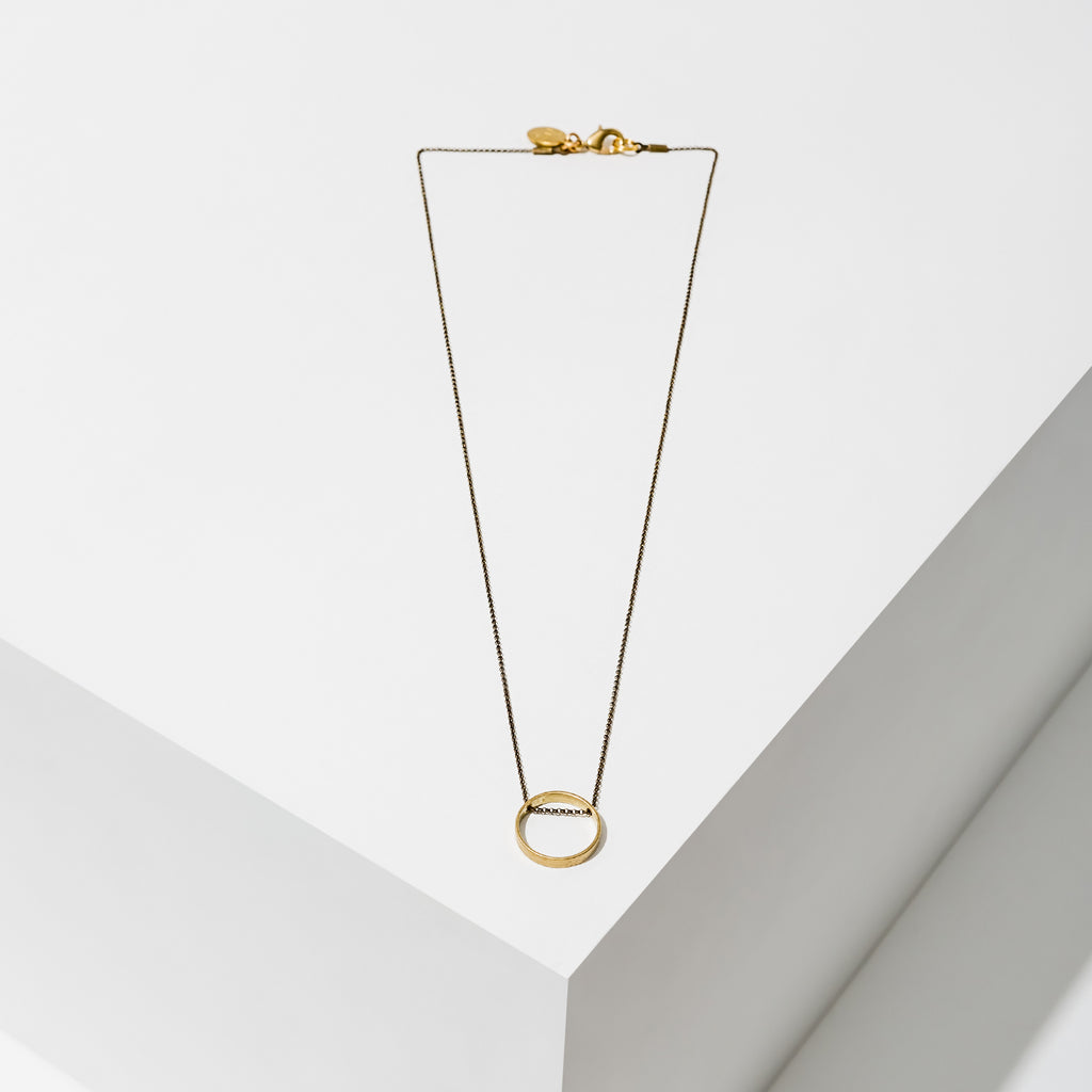 Larissa Loden Jewelry, Handmade in MN. Horizon Necklace, Geometric brass shapes threaded with delicate antiqued chain. Necklace 18 inches long with clasp.