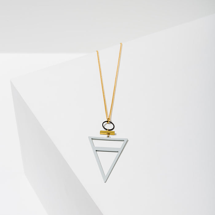 Larissa Loden Jewelry, Handmade in MN. Trine Necklace, Rubberized brass triangle for a matte look and feel. Necklace 30 inches long with clasp.