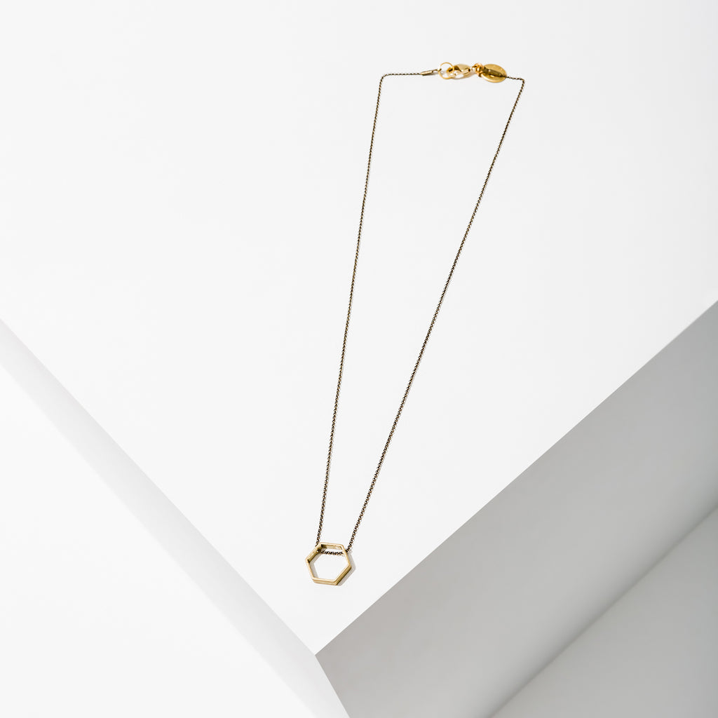 Larissa Loden Jewelry, Handmade in MN. Horizon Necklace, Geometric brass shapes threaded with delicate antiqued chain. Necklace 18 inches long with clasp. Available in a variety of sizes, with silver or brass finish.