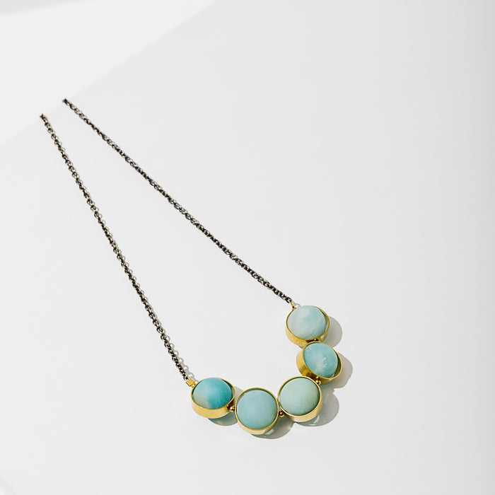 Larissa Loden Jewelry, Handmade in MN. Alignment Necklace, Matte gemstone beads free floating in brass or silver rings hang from matching chain. Necklace 18 inches long with clasp.