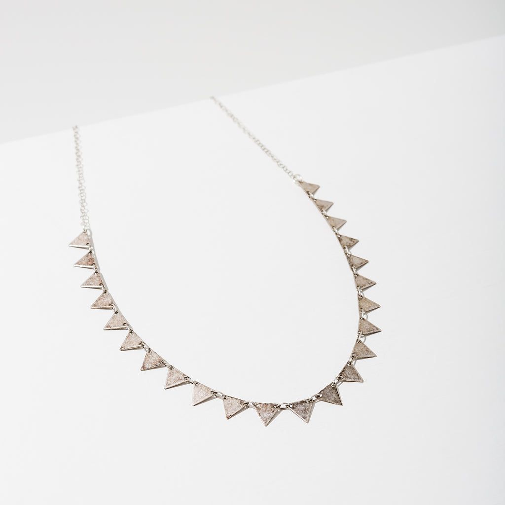 Larissa Loden Jewelry, Handmade in MN. Candra Necklace, Triangles plated with matte gold or an antiqued silver finish. Necklace 15 inches long with a 2 1/2 inch extender for adjustability.