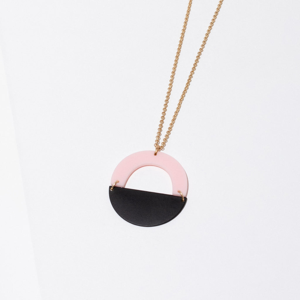 Larissa Loden Jewelry, Handmade in MN. Forme Necklace in pink, Acrylic and powder coated brass shapes in a circular pendant. Necklace is 30 inches long with a clasp.