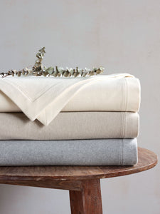 Brera Ivory Solid Flannel 100% Cotton Blanket