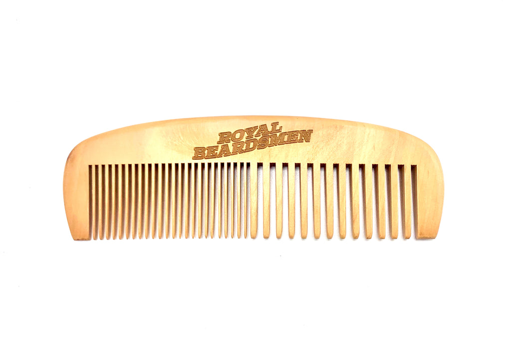 Dual action wooden beard comb