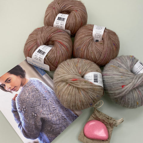 Five balls of Berroco Mochi yarn, a Mochi pattern booklet, and a Cocoknits tape measure