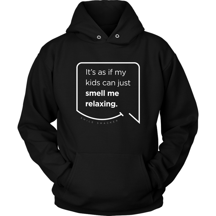 Our funny quotes make the best gifts for Mom! Front view of our soft black hoodie. The modern white quote bubble reads: It's as if my kids can just smell me relaxing.