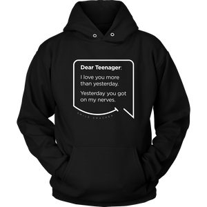 Our funny quotes make the best gifts for Mom! Front view of our soft black hoodie. The modern white quote bubble reads: Dear Teenager: I love you more than yesterday. Yesterday you got on my nerves.