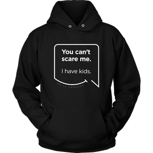 Our funny quotes make the best gifts for Mom! Close-up view of our soft black hoodie. The modern white quote bubble reads: You can't scare me. I have kids.