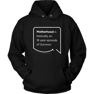 Our funny quotes make the best gifts for Mom! Front view of our soft black hoodie. The modern white quote bubble reads: Motherhood is basically an 18 year episode of Survivor.
