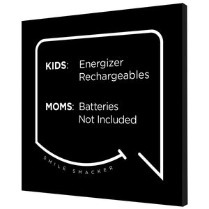 Our funny quotes make the best gifts for Mom! Angled view of our trendy black wall art canvas. The modern white quote bubble reads: Kids: Energizer Rechargeables. Moms: Batteries Not Included.