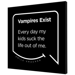 Our funny quotes make the best gifts for Mom! Angled view of our trendy black wall art canvas. The modern white quote bubble reads: Vampires Exist. Every day my kids suck the life out of me.