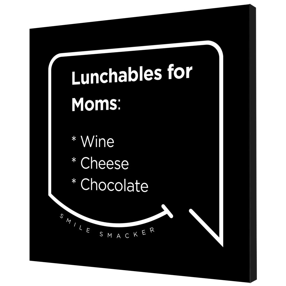 Our funny quotes make the best gifts for Mom! Angled view of our trendy black wall art canvas. The modern white quote bubble reads: Lunchables for Moms: wine, cheese, chocolate.