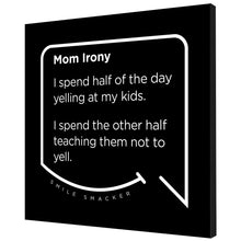 Our funny quotes make the best gifts for Mom! Angled view of our trendy black wall art canvas. The modern white quote bubble reads: Mom Irony. I spend half of the day yelling at my kids. I spend the other half teaching them not to yell.