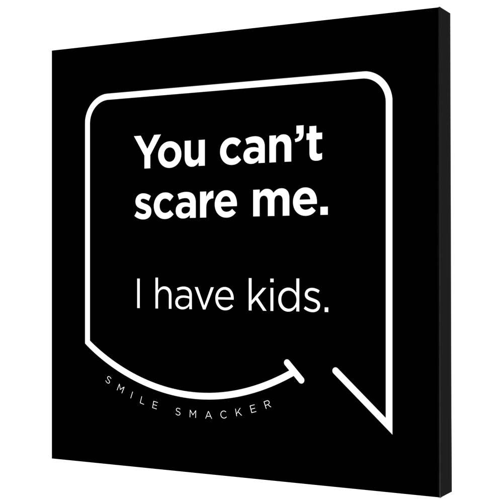 Our funny quotes make the best gifts for Mom! Angled view of our trendy black wall art canvas. The modern white quote bubble reads: You can't scare me. I have kids.
