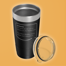 Our funny quotes make the best gifts for Mom! Overhead view of our classic 20 oz black travel mug. The modern etched quote bubble reads: Warning: The Game of Life will not prepare you for Motherhood. Dear Milton Bradley, please update your instructions.