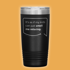 Best mom gifts featuring funny quotes. Front view of our classic 20 oz black travel mug. The modern etched quote bubble reads: It's as if my kids can just smell me relaxing.