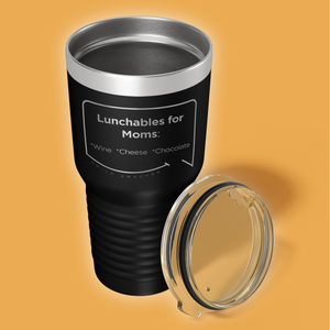Our funny quotes make the best gifts for Mom! Overhead view of our extreme 30 oz black travel mug. The modern etched quote bubble reads: Lunchables for Moms: wine, cheese, chocolate.