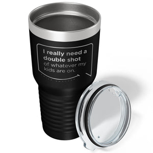 Our funny quotes make the best gifts for Mom! Overhead view of our extreme 30 oz black travel mug. The modern etched quote bubble reads: I really need a double shot of whatever my kids are on.